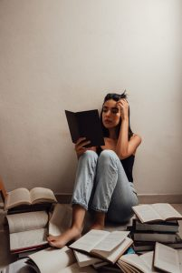 woman reading Portuguese books